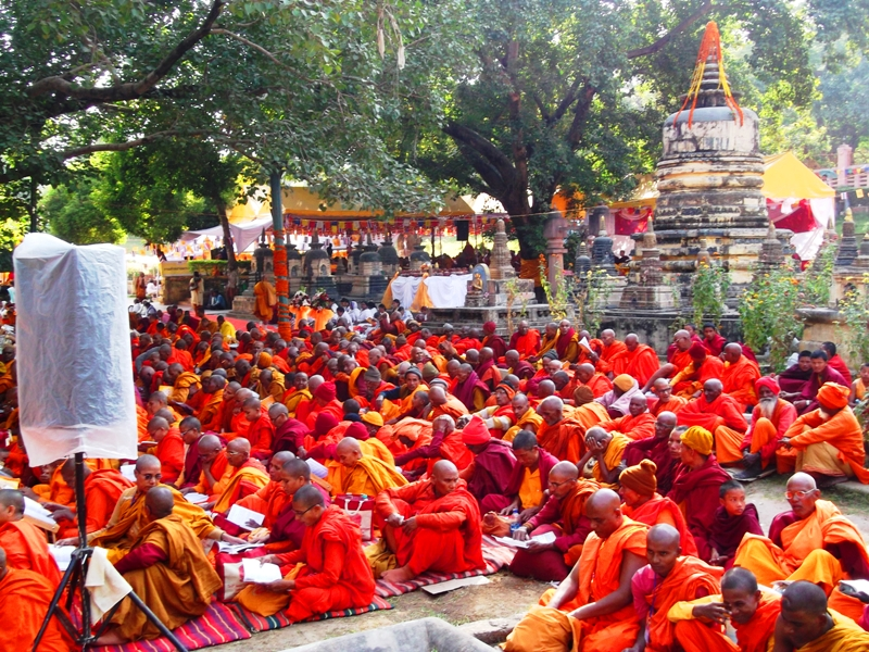 Monks and devotees from different countries offering dhamma to lord Buddha in temple premises