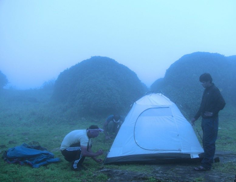 Pitching tent at Kumara Parvatha peak
