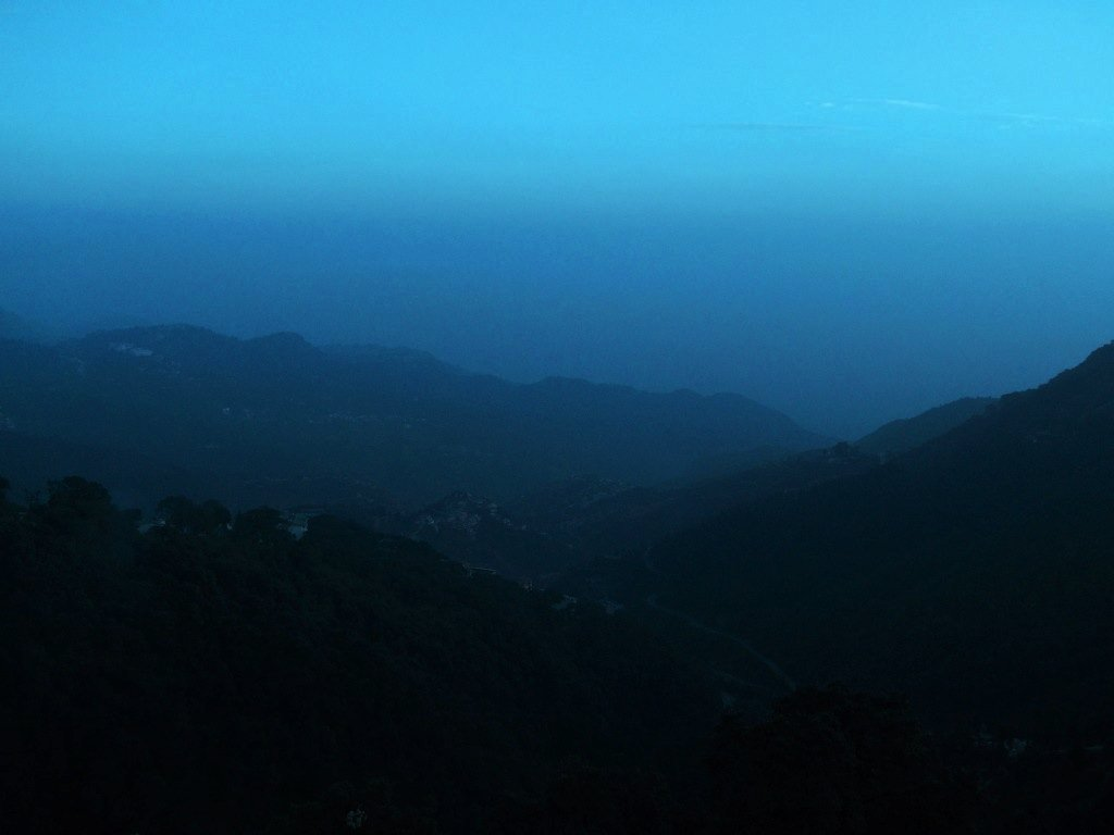 A foggy & dark day over valleys around Mussoorie