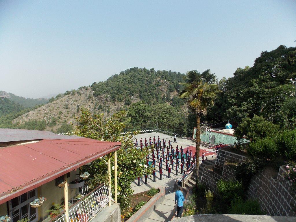 Prayer in Basketball court in a Mussoorie school