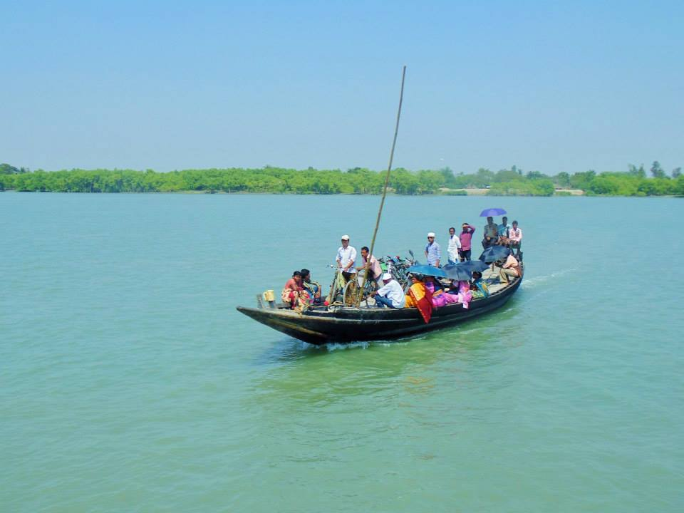 People use boats to cross from one to another island in Sundarbans