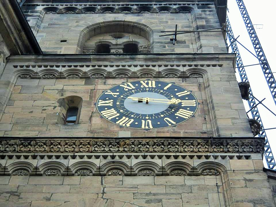 Big golden watch at the front wall of the Bamberg Cathedral