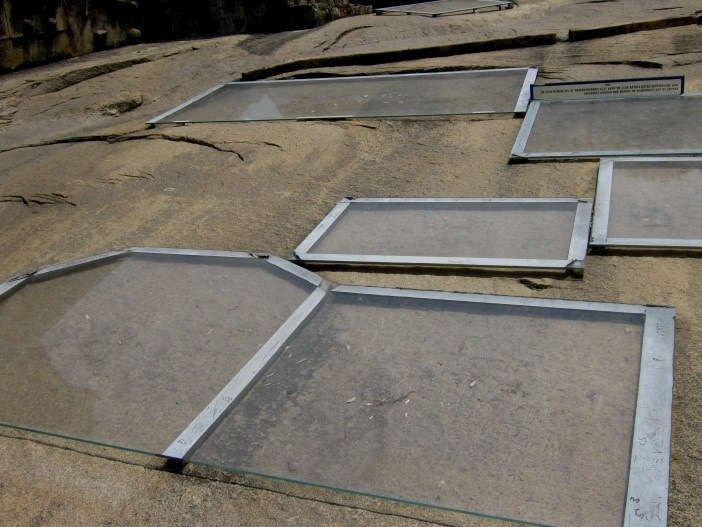 glass slabs covering inscriptions at the shravanabelagola
