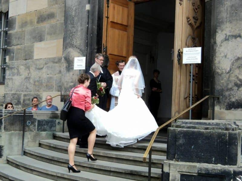 A bride going inside a church in Dresden