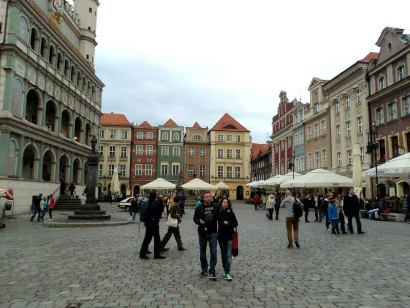 a-couple-strolling-in-old-town-square-of-poznan