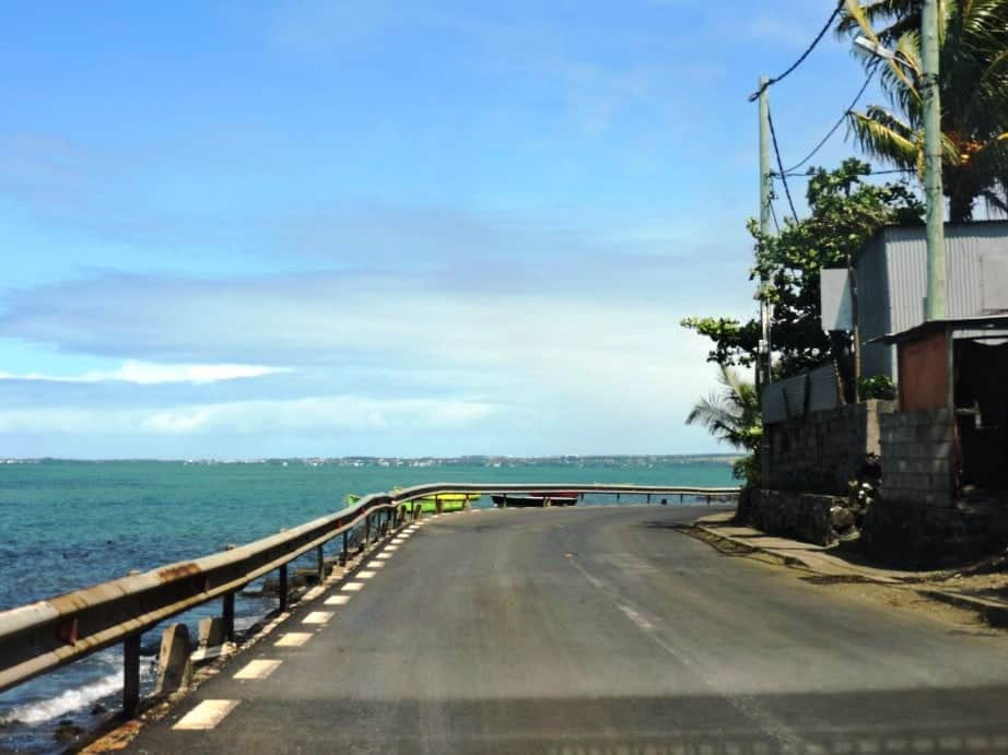 Coastal road of North Mauritius - Mahebourg in the background