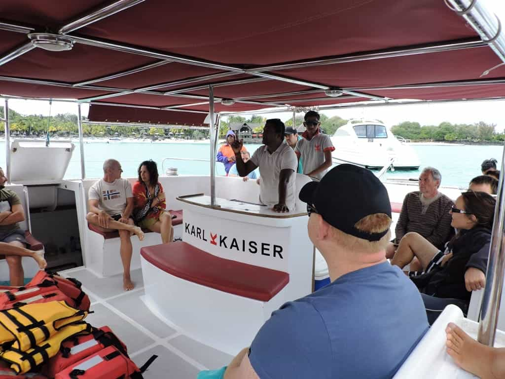 The ship driver briefing the tourists on a catamaran