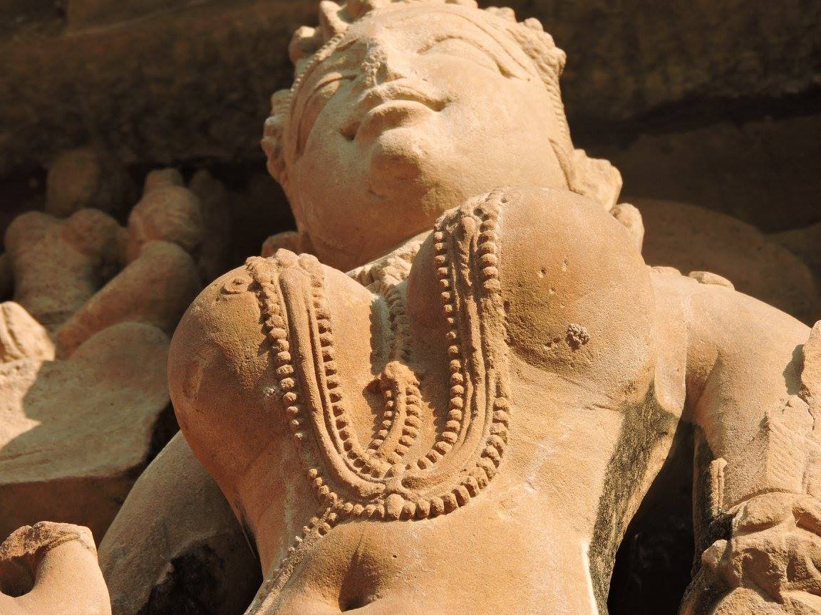 Statue of a woman with large bosoms in Khajuraho