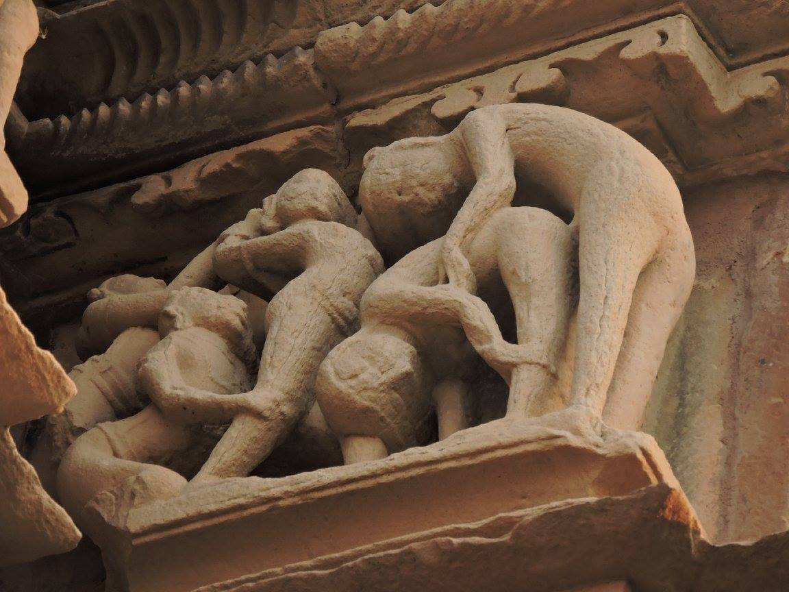 Statue of group love making in Khajuraho