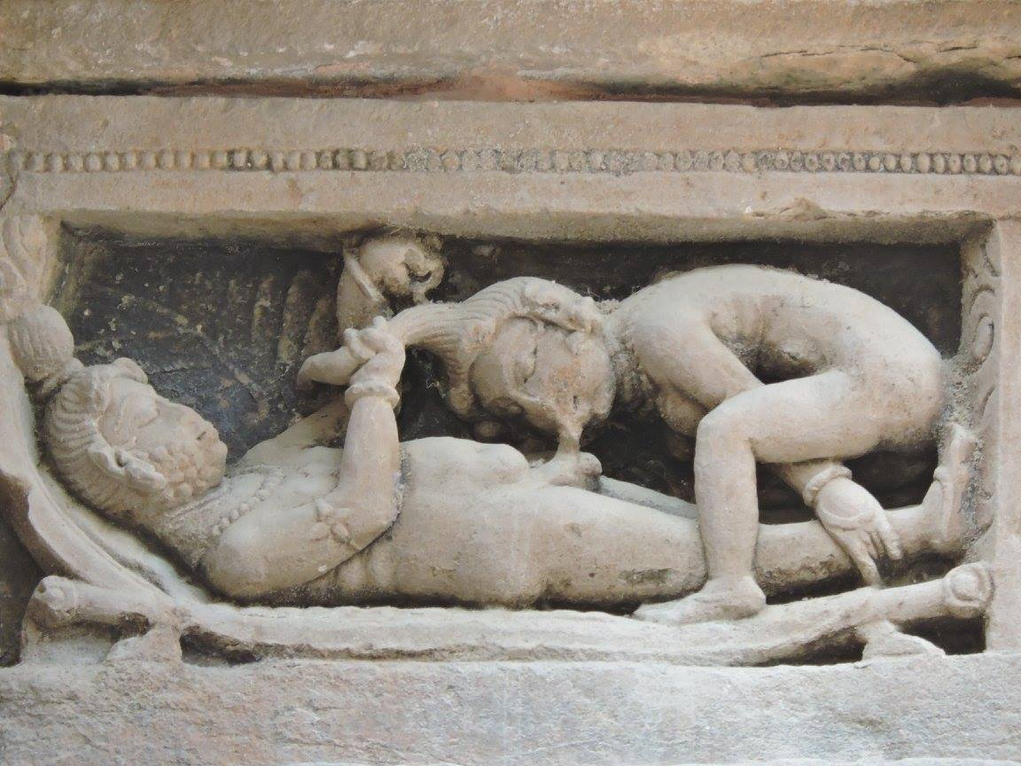 Statue of a woman sucking the man's organ in Khajuraho