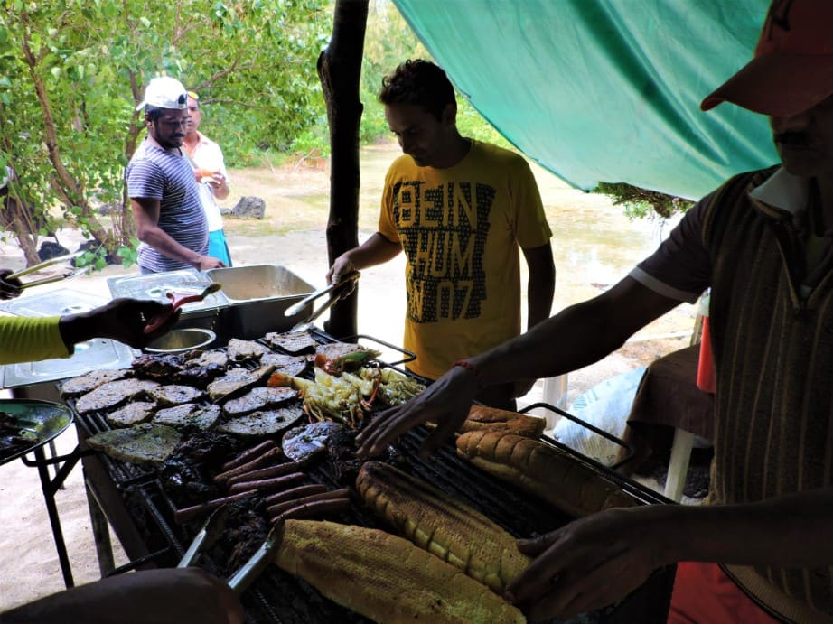 Trying barbecue in Mauritius
