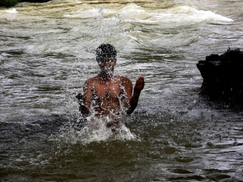 Bathing in river Kaveri at Dubare