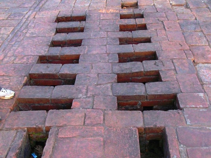 Cooking chulla or oven at Nalanda University